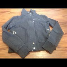 Dark grey Jacket.  Junior Jacket is zipper down and snaps.Front zipper pockets. Double collar. Gently worn. In good condition. Forever twentyone Jackets & Coats