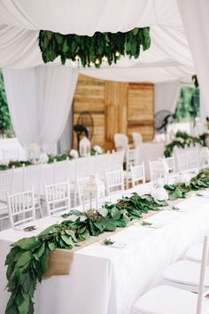 Danial's green thumb inspired his 'green'-themed wedding with wife Harisha at K'Seena House, Kuala Lumpur. Decorated by Chenta Weddings and shot by Fad Manaf Wedding & Portrait Photography, this beautiful Muslimwedding featured long tables lined with an abundance of fresh leaves, custom-made wooden light fixtures and a pelamin (wedding dais) surrounded by crisp, white flowers – all under a white canopy set against a lush garden setting.