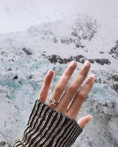 Blogger Nellie Lim's beautiful proposal amongst the snow-capped mountains of Mount Cook, New Zealand with her gorgeous rose gold diamond engagement ring inspired by a snowflake // Proposal ideas and inspiration {Facebook and Instagram: The Wedding Scoop}