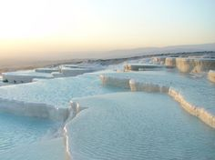 The travertine pools of Pamukkale, Turkey. Pamukkale is now a UNESCO World Heritage Site and the pools have been closed to the tourists that once bathed in their waters to save them from further damage. Places Around The World, Oh The Places You'll Go, Places To Travel, Places To Visit, Around The Worlds, Pamukkale, World's Most Beautiful, Beautiful Places, Amazing Places