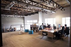 An old bottle factory transformed into a cool loft office space. Open floor plan with modular Bivi desks systems to allow mobility and iteration. (Scout Branding Co., Alabama)