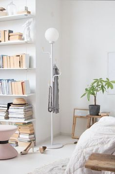 Bedroom lighting Inspiration with Swedish Ninja's Big Darling Floor Lamp. Clever storage with brass detail hooks.