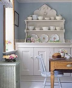 pale blue walls   white cabinets   open shelving