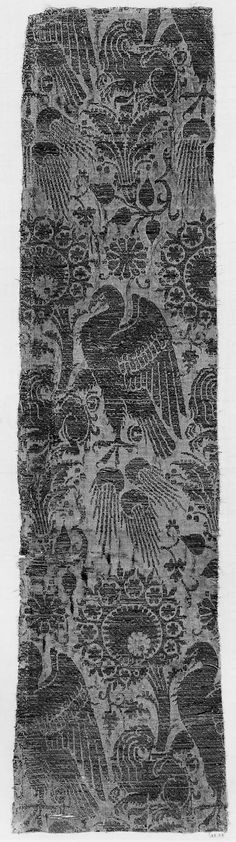 Textile fragment 14th century Fragment of faded salmon silk ground patterned in gold-metallic thread with palmettes and eagles