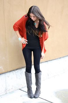 Coral/orange cardigan paired with black outfit, turquoise jewelry