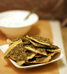 Middle Eastern dish:   Za'atar Pita Chips with Yogurt Dip    4 tablespoons za'atar  5 tablespoons olive oil  2 large pitas (or 4 small size pitas)  1 cup plain greek yogurt  1 tablespoon mint, chopped  1 small garlic clove, grated or minced  1/8 teaspoon salt