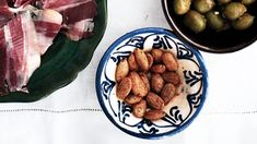 These Marcona almonds need only three more ingredients to become your next go-to bar snack: olive oil, smoked paprika, and flaky salt. Recipes Appetizers And Snacks, Quick Appetizers, Thanksgiving Appetizers, Appetizer Dips, Healthy Snacks, Dinner Recipes, Paprika Recipes, Spicy Almonds, Savarin