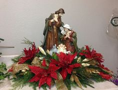 How to Make Christmas Centerpieces. Christmas is mainly a fun for children and parents too as they enjoy their holidays and Christmas party together. Church Christmas Decorations, Christmas Nativity Scene, Christmas Centerpieces, Christmas Flower Arrangements, Christmas Flowers, Christmas Wreaths, Christmas Ornaments, Floral Arrangements, Christmas Projects