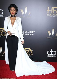 White hot! Janelle Monáe looked divine in a dramatic white number that skimmed the floor...
