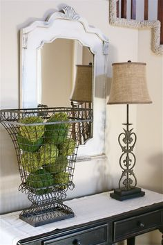 Love the decor - especially the mossy balls in the wire urn.  She also shows you on her blog how to make the moss balls.
