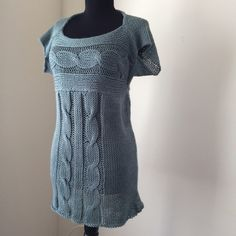 Loose Knit Cabled Cap Sleeve Sweater or Mini Dress Sheer and lacy soft cable knit cap sleeve sweater or sweater dress. It's loose fitting on my mannequin which 32-24-32, wear as a mini dress if you're petite or size XS-S. Could fit up to M as a top.  Cute with a nude dress slip or as a long top with a bandeau. Warm, soft, bouncy, and drapey. Halter neckline, flattering cap sleeves, and easy loose fit. Made of acrylic baby yarn that's machine washable. Color is like a slate blue or dove grey…