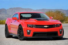 The Chevy Camaro is so fast, you might not even see it in this photo! If you miss it, come to Amesbury Massachusetts Chevy to see the real thing. Camaro Zl1, Chevy Camaro, Camaro Auto, 2013 Chevrolet Camaro, Super Fast Cars, Super Sport Cars, Gta, Custom Camaro, Chevy Muscle Cars