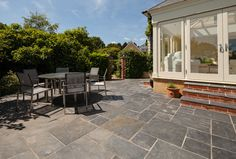 Blue Crag Slate paving stones are an even-coloured, stylish slate with blue and grey tones. Flagstone Paving, Slate Paving, Outdoor Paving, Paving Stones, Hearth Stone, Slate Hearth, Modern Patio Design, Contemporary Patio, Fire Pit Seating