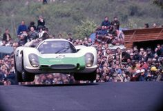 Porsche 908/2 driven by Rudi Lins and Willy Kauhsen takes off at Flugplatz during the Nurburgring 1000km in 1970.