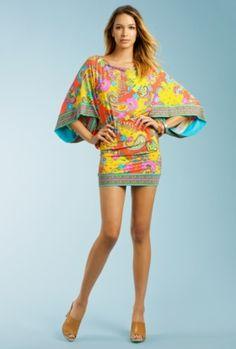 (Summer of Love Tunic by Trina Turk). I like the slender waist.
