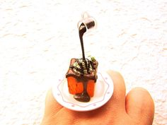 Kawaii Food Ring Chocolate Sauce Ice Cream on Bread Floating Japanese Ring. $16.50, via Etsy.