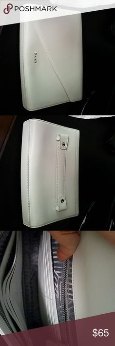 DKNY White Clutch New Sleek DKNY White Clutch, never used, leather, built in card holders, zippered pocket, comes with dust bag Dkny Bags Clutches & Wristlets