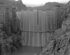Back view of the Hoover Dam prior to the formation of Lake Mead. Water can already be seen at the base of the dam Hoover Dam Construction, Land Surveyors, Hydroelectric Power, Boulder City, Lake Mead, Colorado River, History Photos, Le Moulin, Vintage Photographs