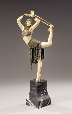 Antinea, a cold painted bronze and ivory figure of an Egyptian dancer (circa 1928), by Demetre Haralamb Chiparus (1886-1947). Description from pinterest.com. I searched for this on bing.com/images