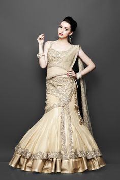 Gold color lehenga with embroidery work