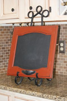 Chalkboard Cabinet Door - remove hinges, paint inner panel with chalkboard paint, mount on tripod stand - write away!