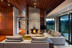 Modern ranch style home with land-loving layout and materials
