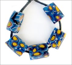 Five beautiful rare antique Venetian matte millefiori glass beads from the early 1900's.  These are special beads in that they were made for the African trade but were never circulated and they are in pristine condition. SOLD