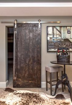 """The Natural Barn Door The Natural Barn Door is a bold and unique design, perfect for a rustic finish! Available in Pine, Alder, or Oak. This door looks great stained or painted."" (quote) via graftedhardware.com"