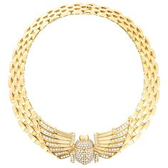 Cartier Egyptian Revival Diamond Gold Scarab Necklace | From a unique collection of vintage chain necklaces at https://www.1stdibs.com/jewelry/necklaces/chain-necklaces/