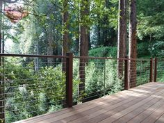 Great photo of a wood cable railing nestled in the redwood forest from the gallery at DecksGo Backyard Patio, Backyard Landscaping, Cable Fencing, Wood Deck Railing, Stainless Steel Cable Railing, Cabin Decks, Redwood Forest, Deck Design, House Colors