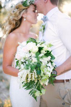 Lush white blooms with lots of greenery: http://www.stylemepretty.com/australia-weddings/queensland-au/2015/01/13/elegant-beach-wedding-on-stradbroke-island/ | Photography: Bird and Boy - http://www.birdandboyphotography.com.au/