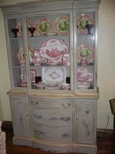Mahogany painted and distressed gray china cabinet filled with red transferware and covered in two coats of antique wax. Repurposed Furniture, Painted Furniture, Small Dining Area, Chalk Paint Projects, Antique Wax, China Cabinet, Coats, Gray, Antiques