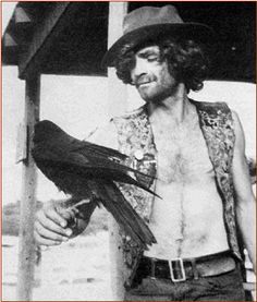 Charles Manson.  He is wearing the vest that the girls embroidered for him, telling the story of The Family.