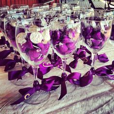 Hershey Kiss Decorating Tutorial — Hershey Kiss wedding favors from One Stop Party Ideas. Displays chocolate kisses in wine glasses with a matching bow.