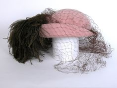 1955 felt, feathers, and net Hat by Rose Descat, France. Via National Trust Collections.