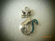 Silver Pewter Cat Charm with Aquamarine Swarovski Flatbacks  Posted to the Stufflicious.com community storefront by saintsflowers. Buy it directly from etsy.com for $8.43 today. #Arts #Crafts #Sewing #Hobbies