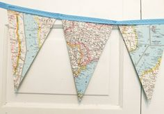 A bunting / banner / garland created from a vintage atlas. The maps in each flag are from various places around the world.  Using an atlas that