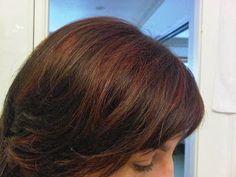 dark brown hair with auburn highlights to red streaks in