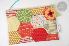Amy Donahue Friend created this fun zippered bag using our hexagon die.  Find her tutorial on our blog at http://sizzixblog.blogspot.com/2013/01/half-hexagon-bag.html.