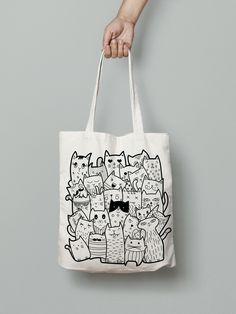 Black and white doodle cats. Cute animals for your design. You can find… Eco bag. Black and white doodle cats. Cute animals for your design. You can find this illustration by click in my link. Thanks for watching! Black And White Doodle, Black Cats, Black White, White Cats, Doodle Bags, Drawing Bag, Animal Doodles, Painted Bags, Linen Bag