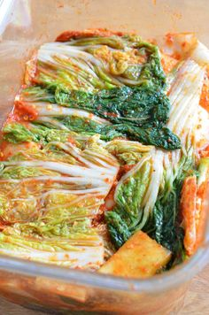 Mak Kimchi top covered with leaves