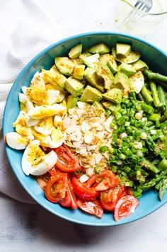 Delicious Asparagus Salad Recipe with tomato, avocado, eggs, toasted almonds and super easy dressing. Healthy and quick way to eat more cheap asparagus in season. #ifoodreal #healthy #asparagus #salad #cleaneating
