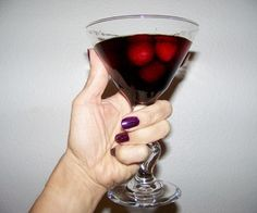 Walking Dead Tonic     Fill Martini glass with Frozen raspberries     Add Equal parts     1 1/2  oz Godiva Raspberry Chocolate Vodka.     1 1/2 oz  Kahlua (original)