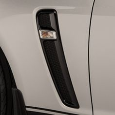 SS Side Fender Vents:Blackout fender vent trim replaces the bright production trim and side marker lamp assembly on SS for a whole new take on hot performance looks.