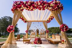Like the gold mandap with pops of color and flower clusters