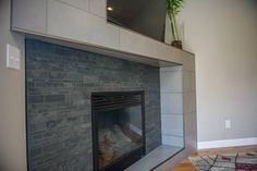 Fireplace and living room remodel and interior design by TVL Creative