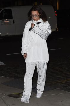 Bella Hadid wearing Hyein Seo South of the Border Track Pants, Hyein Seo South of the Border Tracksuit Top and Le Specs X Adam Selman the Flex Sunglasses