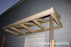 House Renovations: Week 10, Building a Door Roof {or How Awesome is my Daddy