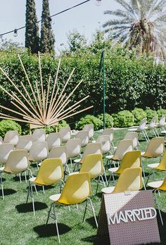 A retro-inspired ceremony altar with an art-deco wooden starburst backdrop | #weddingceremony repinned by wedding accessories and gifts specialists http://destinationweddingboutique.com