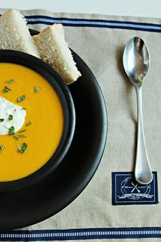 Roasted Carrot Soup: For a smooth surface, you do have to force this through a sieve. Good tip about roasting veggies instead of boiling. Used a bit of milk + sour cream for creme fraiche and dashed in some ginger and nutmeg for the carrots. Good weekday soup.